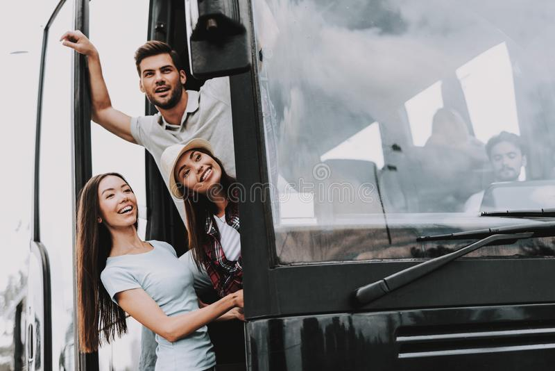 Young Smiling People Traveling on Tourist Bus stock images
