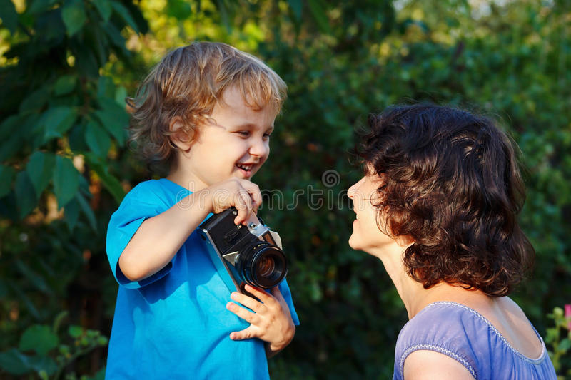 Download Young Smiling Photographer Shoots Her Mother Stock Image - Image: 26005493