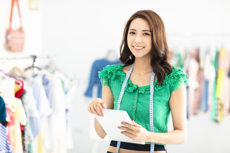 Young smiling Sales assistant in clothing store stock images