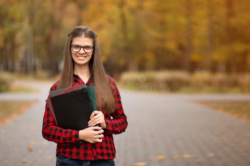 Young smiling  student woman with folders.  Knowledge concept. Young smiling  student woman with folders. University education stock image