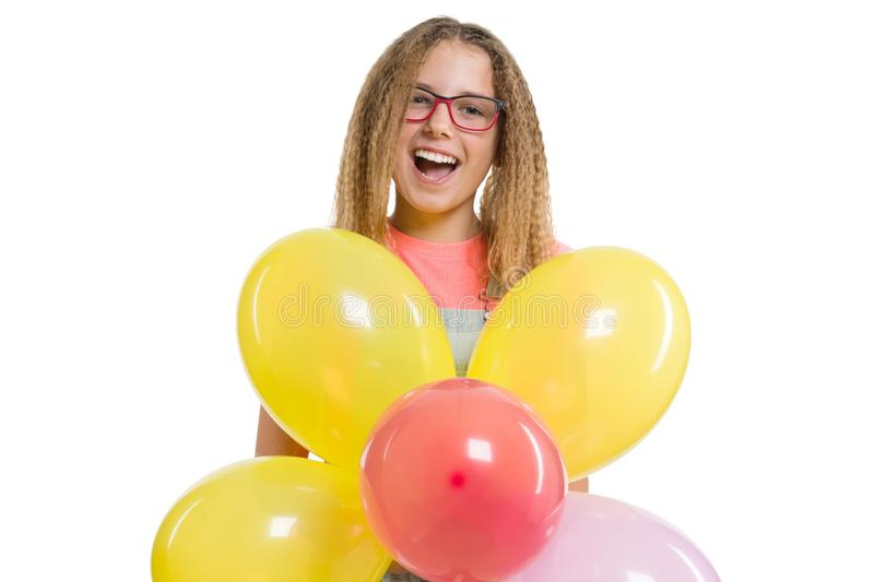 Young smiling teen girl with festive color balloons on isolated white background royalty free stock photography