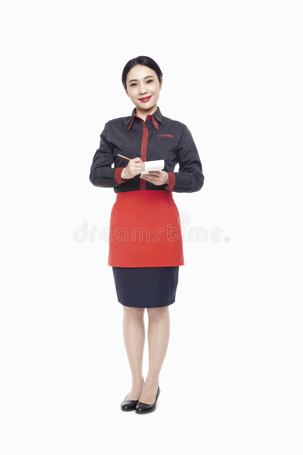 Download Young Smiling Waitress Writing Order On Note Pad, Smiling, Studio Shot Stock Image - Image: 31108315