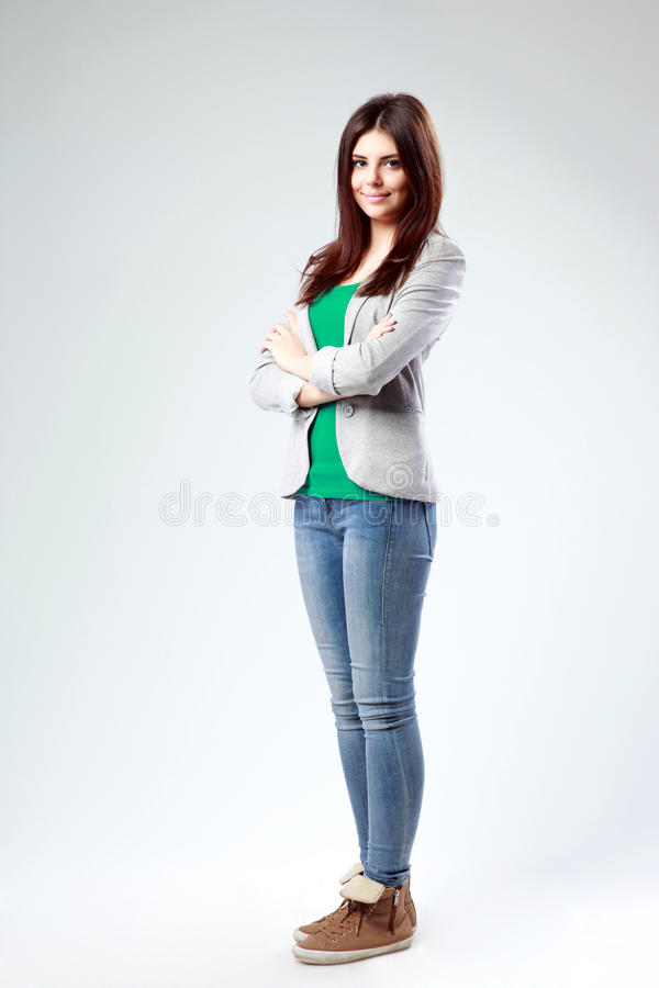 Young smiling woman with arms crossed royalty free stock photography