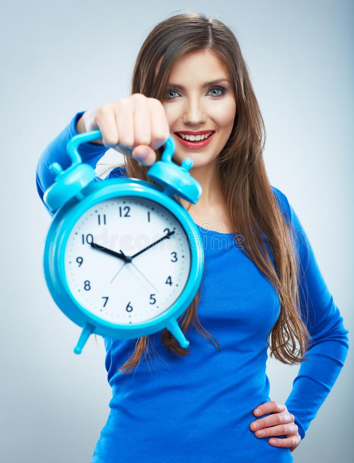 Young smiling woman in blue hold watch. Beautiful smiling girl. Portrait. studio background female model royalty free stock photos