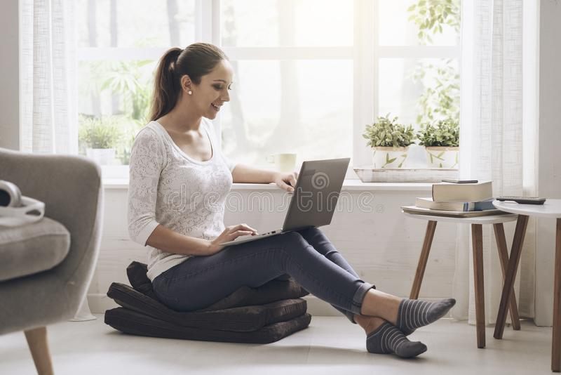 Young woman networking with her laptop at home stock photos