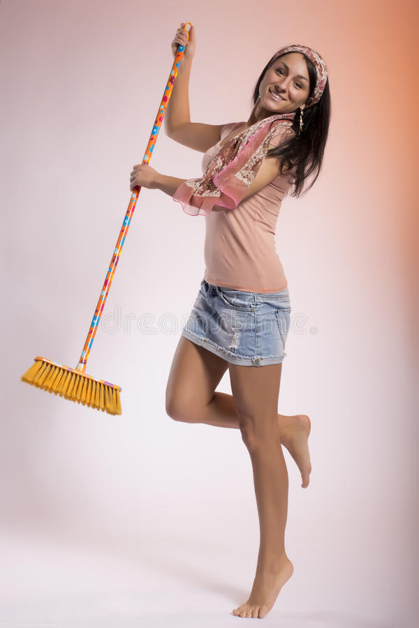 Download Happy housewife with broom stock photo. Image of charming - 29919804