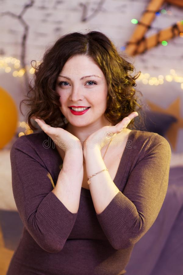 Young smiling woman with hands on cheeks stock photography