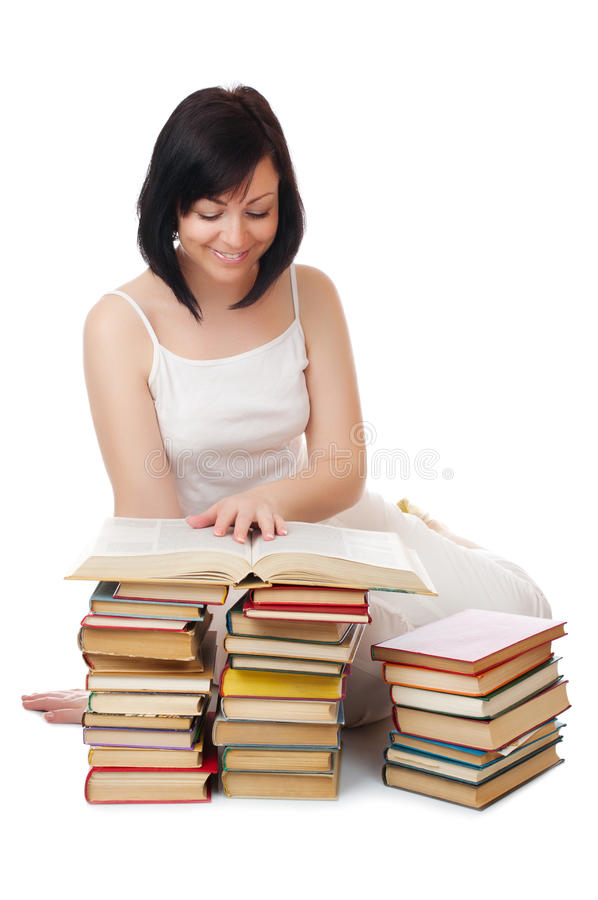 Young smiling woman with heap of books stock photo