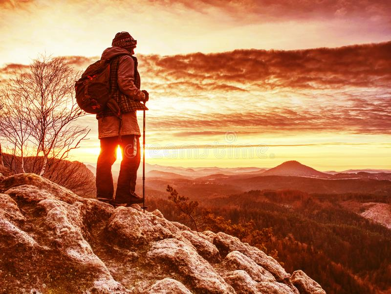 Young smiling woman hiker hiking rocky trail, walking on cliff stock photography