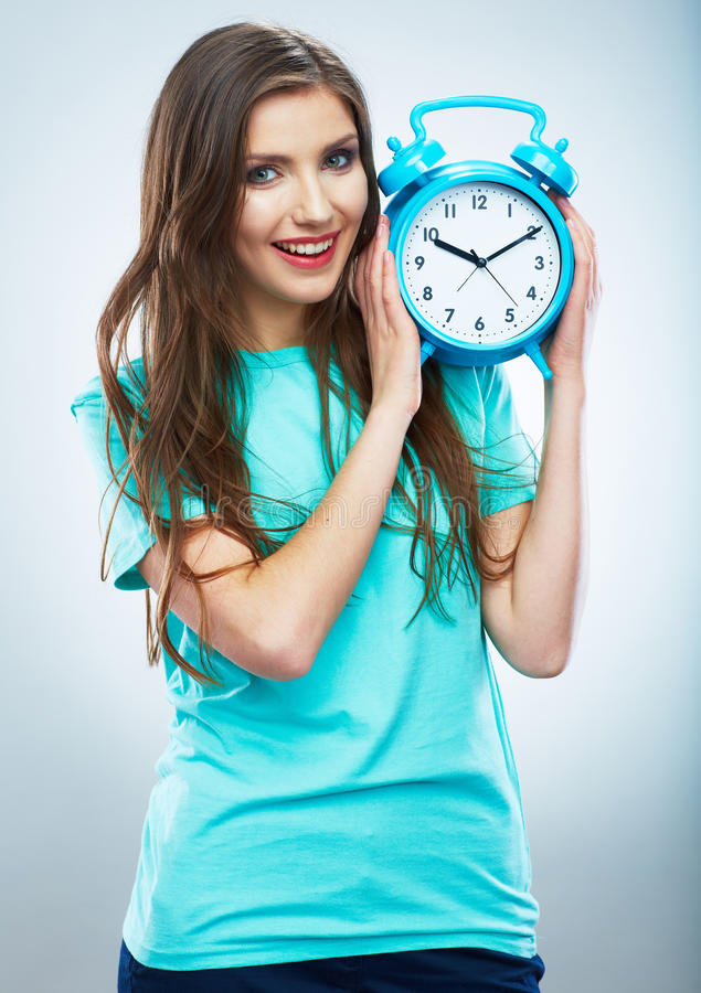 Young smiling woman hold watch. Beautiful smiling girl portrait stock image