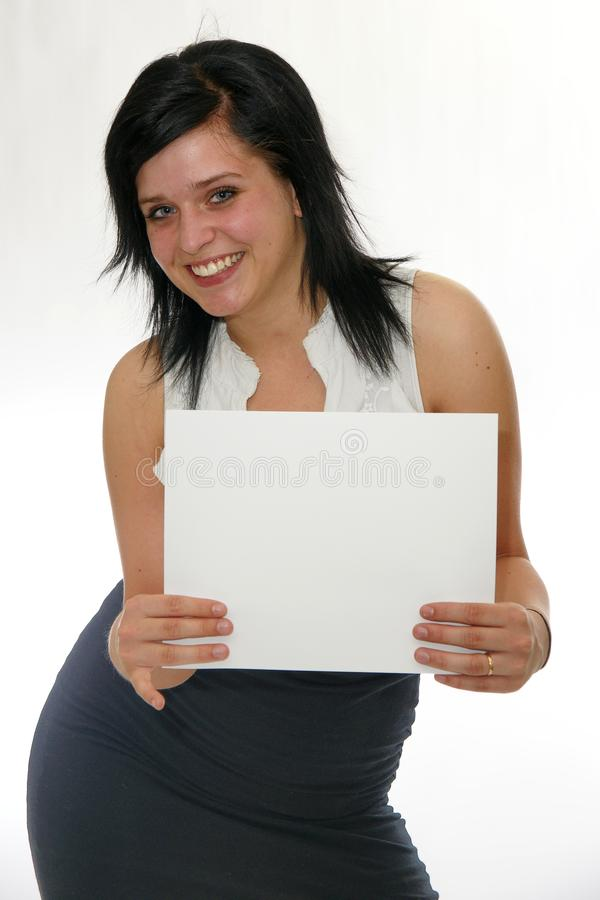 Young smiling woman holding a blank poster royalty free stock image