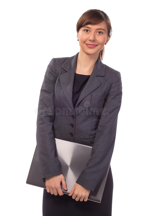 Young smiling woman holding closed laptop isolated. On white background royalty free stock photos