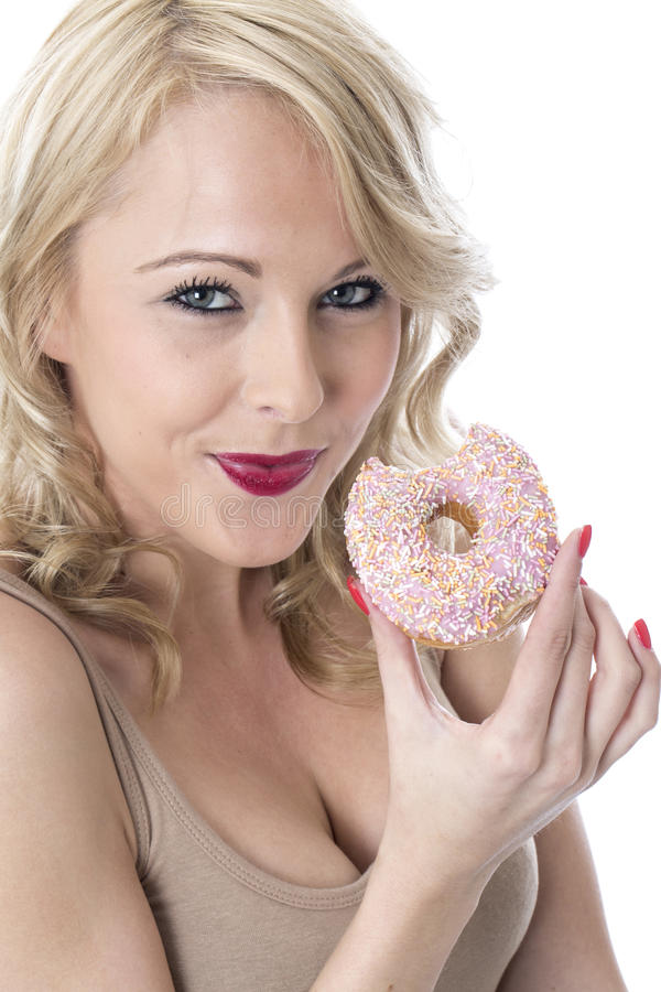 Free Young Smiling Woman Holding Iced Donut With Bite Out Of It Royalty Free Stock Photos - 51114578