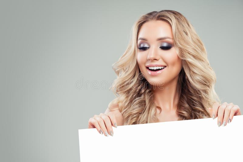 Young Smiling Woman Holding White Blank Board Paper Banner royalty free stock photos