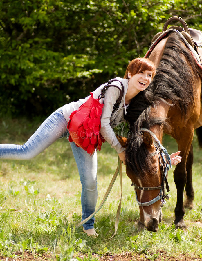 Young smiling woman with horse royalty free stock images