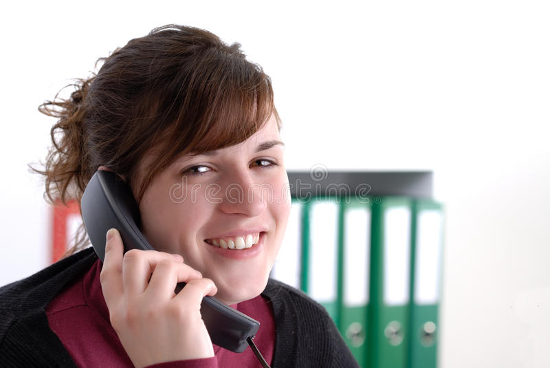 Download Young Smiling Woman On The Phone In Her Office Stock Photo - Image of files, green: 13766290