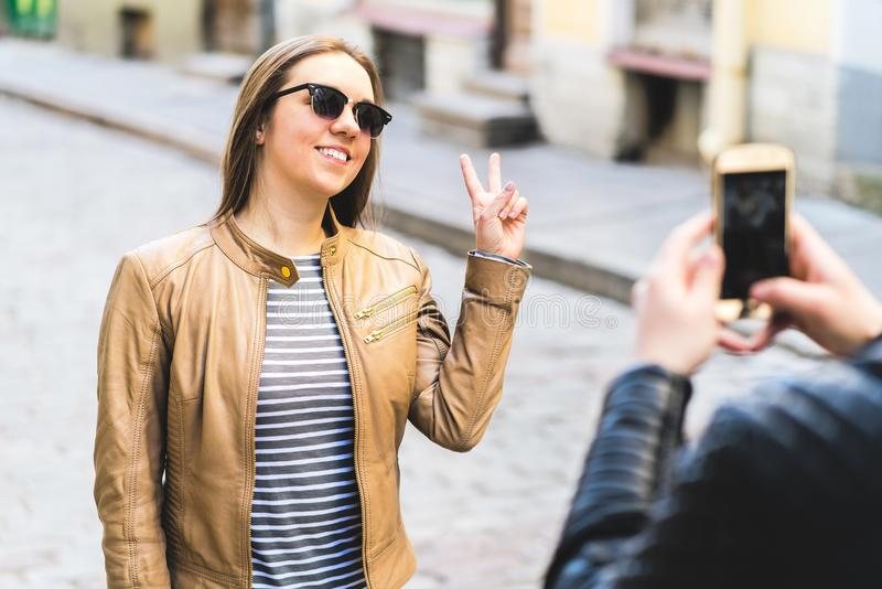 Young smiling woman posing for camera phone royalty free stock photos