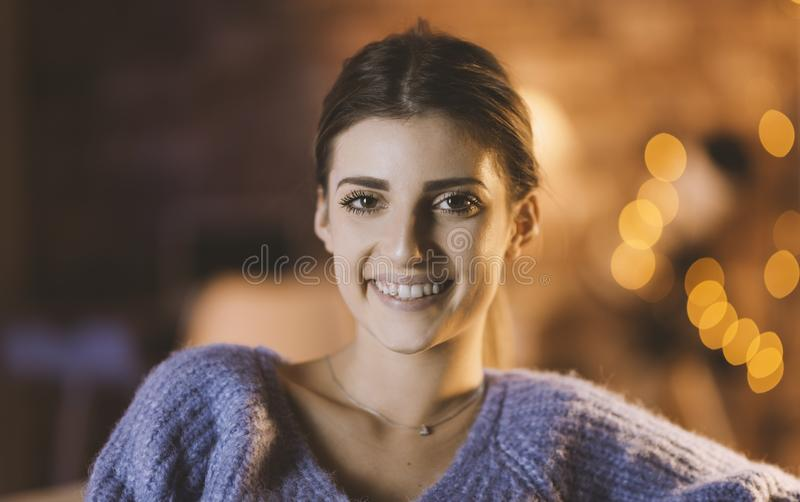 Young woman posing at home royalty free stock photography