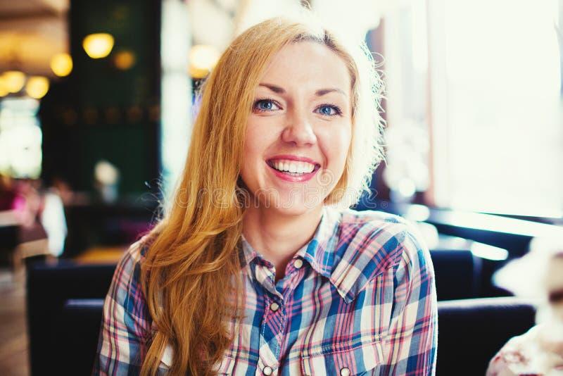 Young smiling blond woman positive portrait. Young smiling woman positive portrait royalty free stock photos