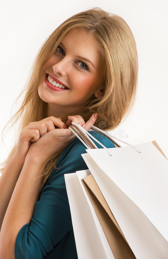 Young smiling woman with shopping bags isolated royalty free stock photos