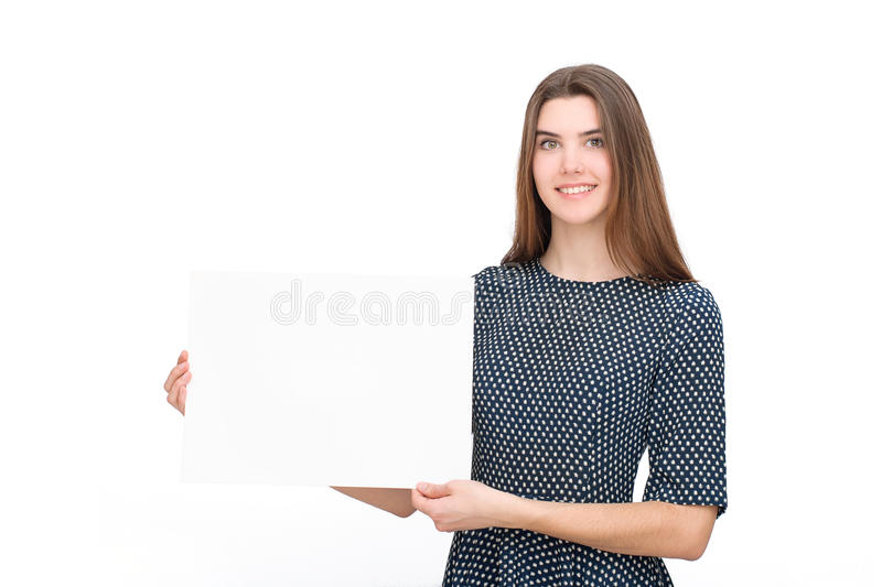 Young smiling woman show blank card or paper royalty free stock photos