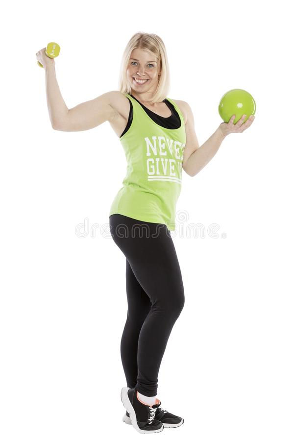 Young smiling woman in sportswear with dumbbell. Aerobics classes. Isolated over white background.al. Young smiling woman in sportswear with dumbbell. Aerobics royalty free stock images