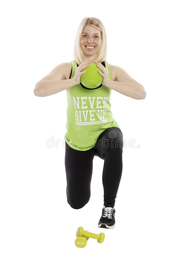 Young smiling woman in sportswear with dumbbell. Aerobics classes. Isolated over white baround. Young smiling woman in sportswear with dumbbell. Aerobics royalty free stock photography
