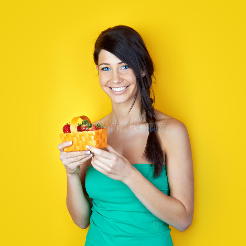 Young smiling woman with strawberries stock images