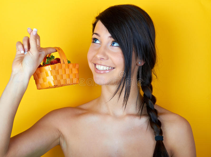 Young smiling woman with strawberries royalty free stock images