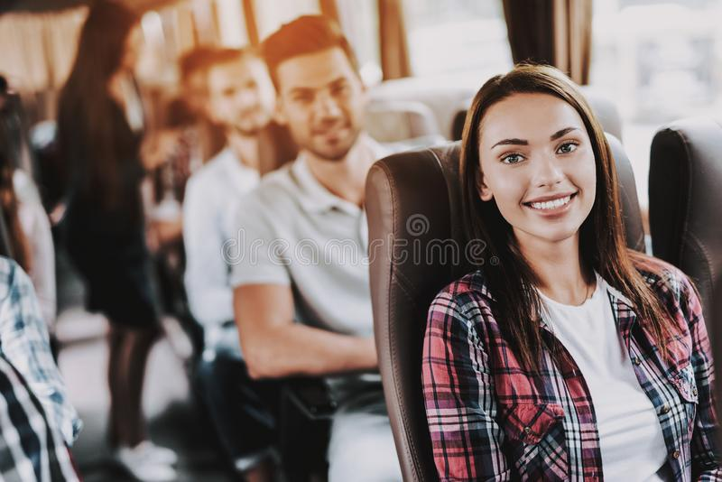 Young Smiling Woman Traveling on Tourist Bus stock image