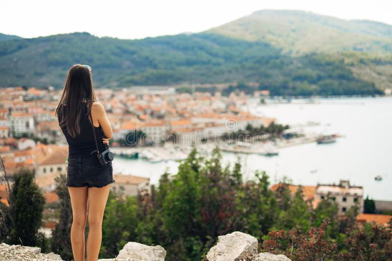 Young smiling woman travelling and visiting Europe.Summer touring Europe and Mediterranean culture.Colourful streets,old stock photo