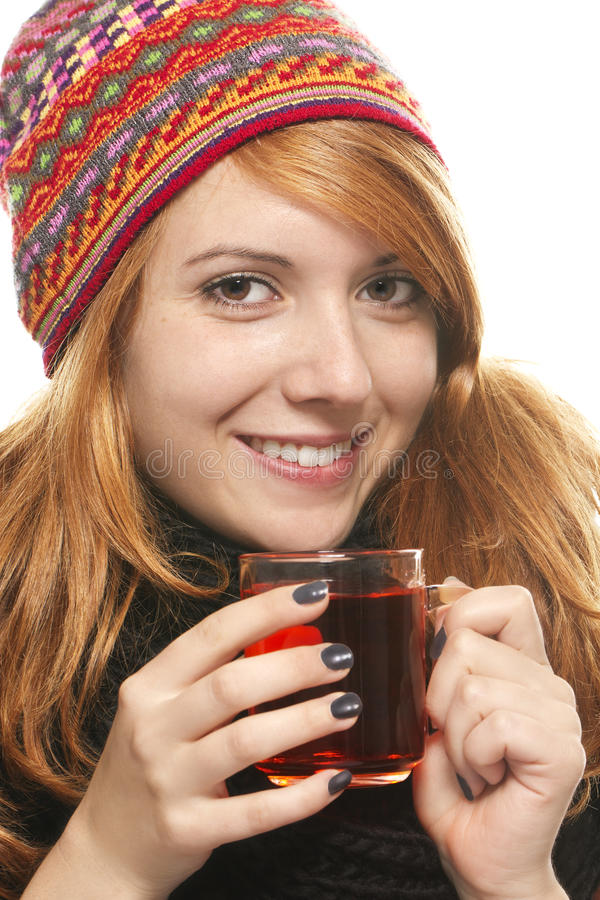 Young smiling woman with winter cap warming-up wit