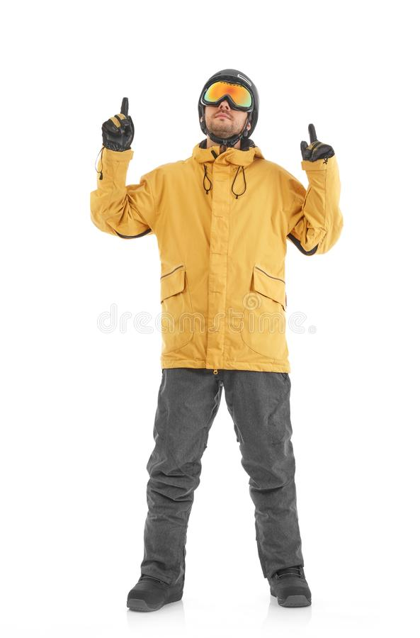 Snowboarder pointing up stock photography