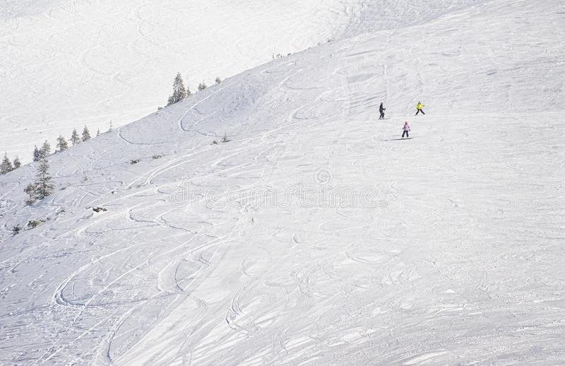 Young snowboarders on ski slope in high mountains royalty free stock image