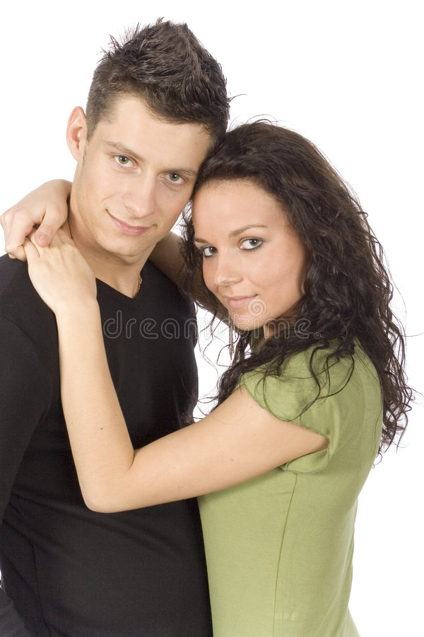 Young snuggling couple stock image