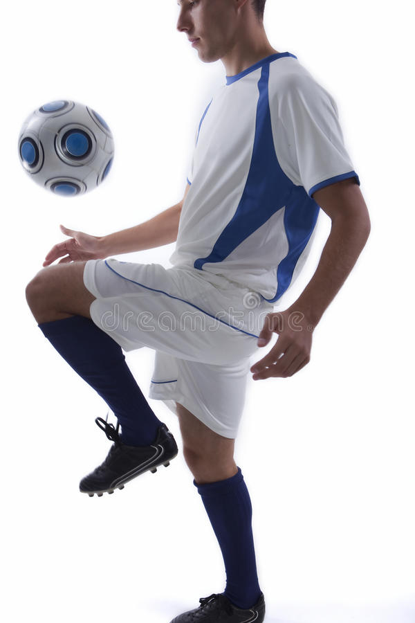Young soccer player in action royalty free stock photo