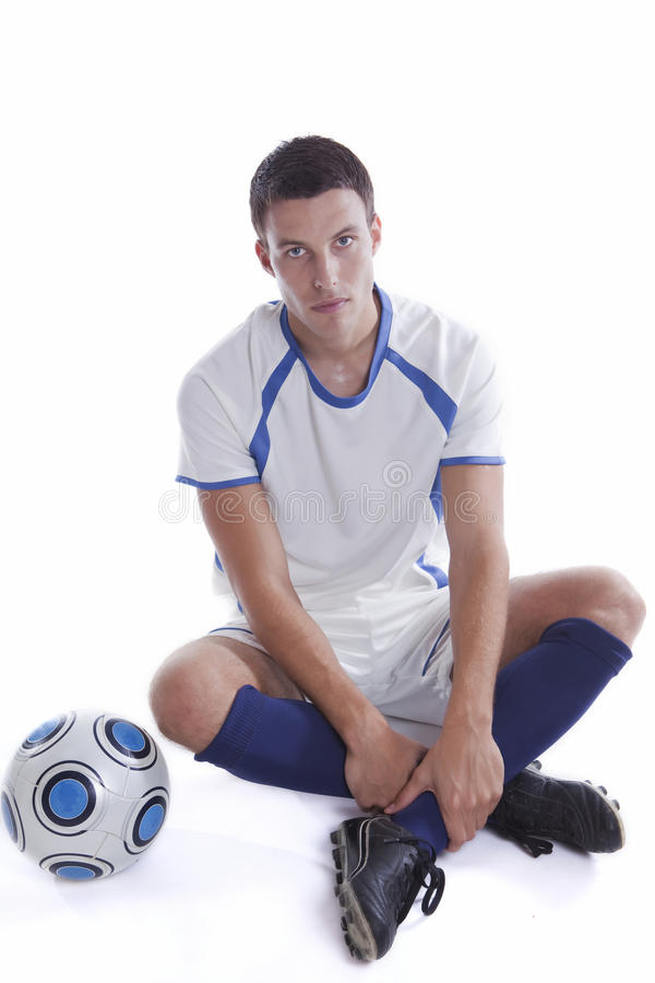 Young soccer player in action stock photo