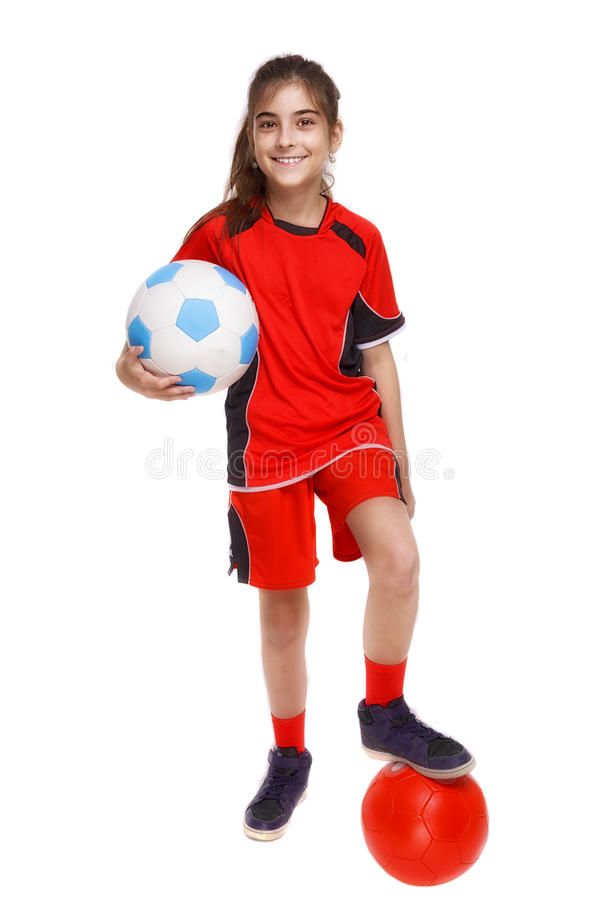 Young Soccer Player with ball isolated on white stock photo