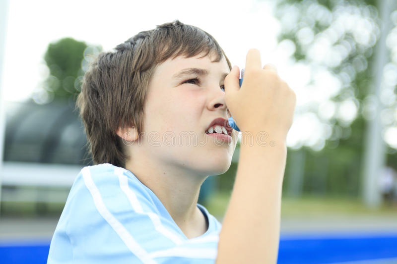 A young soccer player inhalator royalty free stock photo