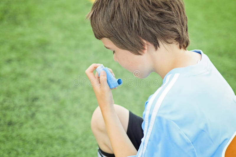 A young soccer player inhalator royalty free stock photography