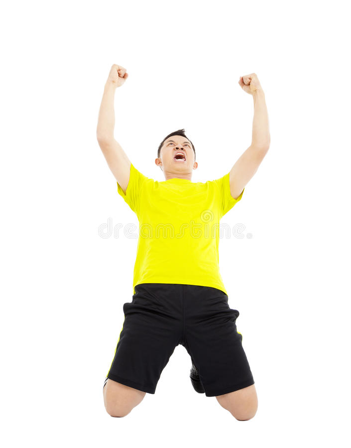 Young soccer player raised hands to celebrate winner royalty free stock images
