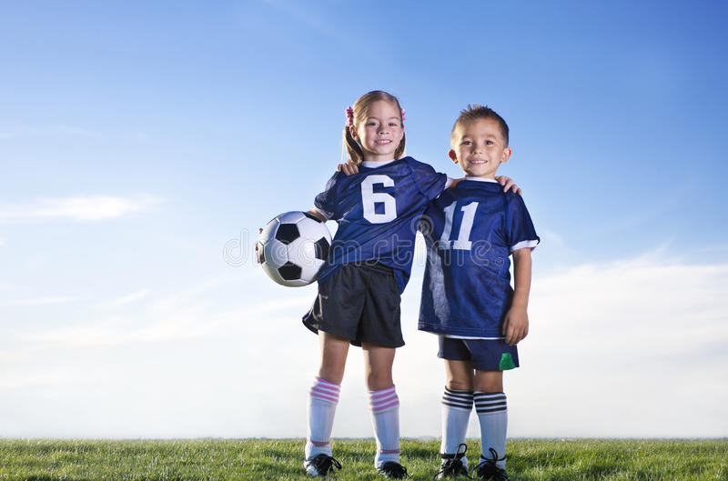 Young Soccer Players on a team. Two Young ethnically diverse soccer players on a youth soccer team stock photo