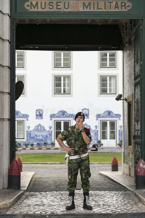 Young soldier in camouflage uniform guarding the entrance to the Military Museum, Lisbon stock photography