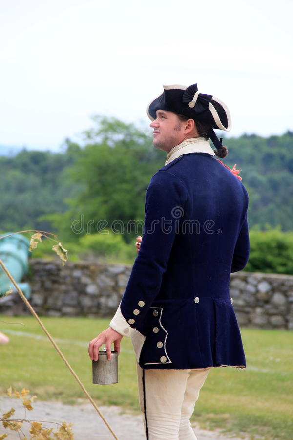 Young soldier drinking first cup of coffee before starting duties,Fort Ticonderoga,2014 royalty free stock photos