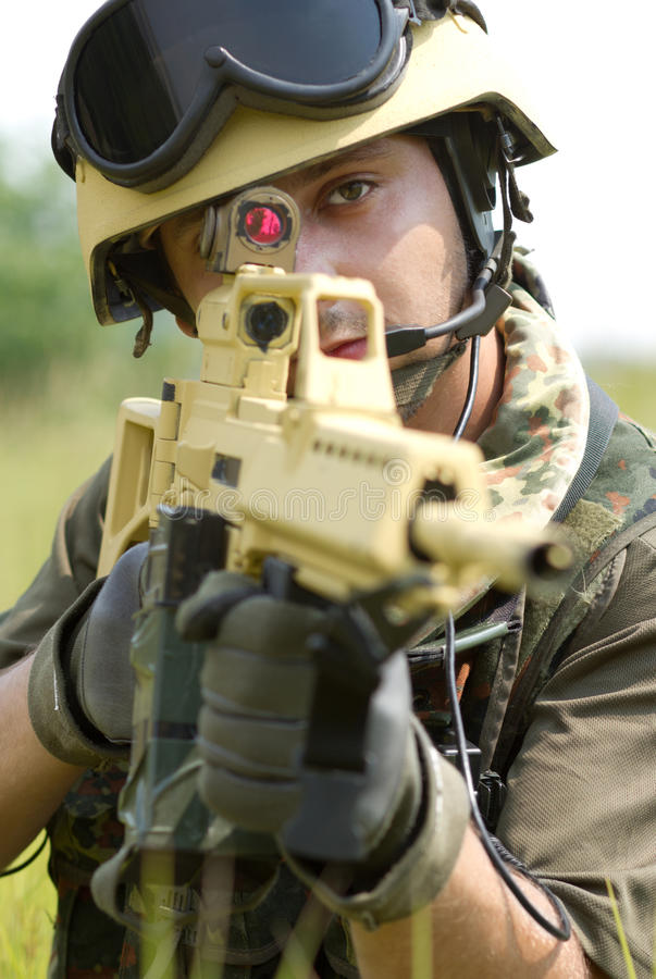 Young soldier in helmet targeting stock photo