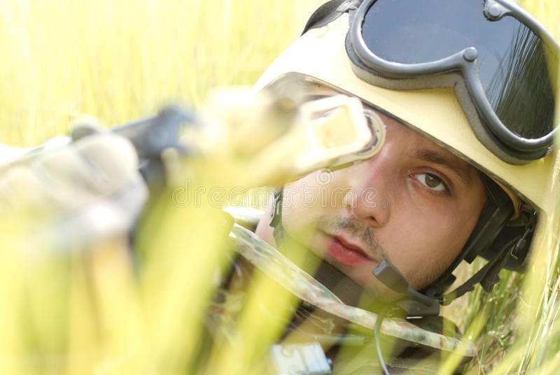 Young soldier in helmet targeting stock photos