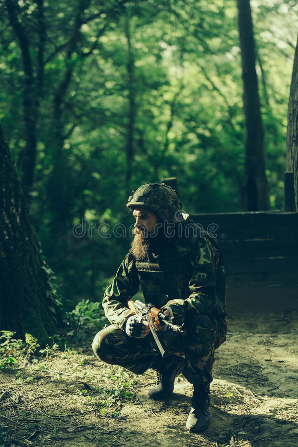 Young soldier with rifle royalty free stock image