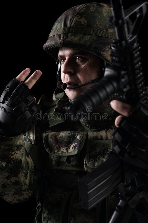 Soldier special forces with rifle on dark background. Young Soldier special forces with rifle on dark background stock image