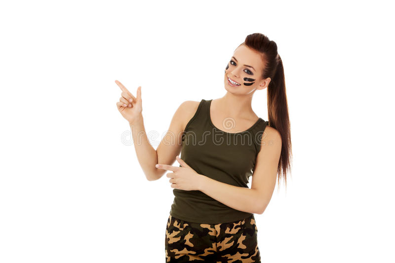 Young soldier woman pointing for something stock image
