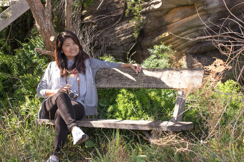 Young South East Asian woman on a bench in spring stock photos